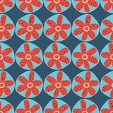 Scandinavian flowers seamless vector background. 1960s, 1970s retro floral design. Red and blue doodle flowers on a blue. Background. Vintage style. For fabric royalty free illustration