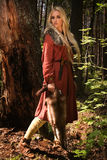 Scandinavian girl  with fur skins. Scandinavian girl with runic signs holding a fur skins Stock Photo