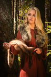 Scandinavian girl  with fur skins. Scandinavian girl with runic signs holding a fur skins Stock Photography