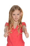 Scandinavian girl holds her thumbs up Royalty Free Stock Photo
