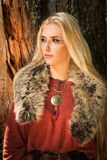 Scandinavian girl with runic signs Stock Images