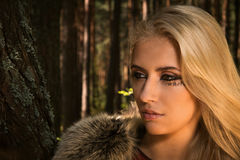 Scandinavian  girl with runic signs in a wood Royalty Free Stock Image