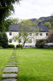 Guest House with Green Lawn and Rocky Path, Norway Stock Photos
