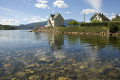 Scandinavian house on hardangerfjord Royalty Free Stock Images