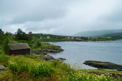 Scandinavian houses near water Royalty Free Stock Photography