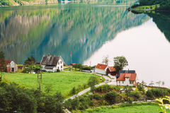 Scandinavian houses on the shore of the narrowest Royalty Free Stock Photography