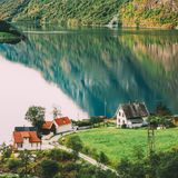 Scandinavian houses on shore of the narrowest fjord in Norway - Naeroyfjord. Top View Of Scandinavian Houses In Norwegian Village On Shore Of The Narrowest Fjord Stock Images