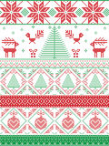 Scandinavian inspired by  Norwegian Christmas and festive winter seamless pattern in cross stitch with Xmas trees, snowflakes. Reindeer, Robin Bird, heart Royalty Free Stock Image