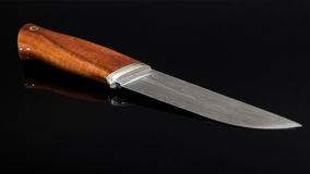 Scandinavian knife. Damascus steel blade Stock Image