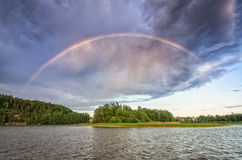 Scandinavian lake landscape with double rainbow Royalty Free Stock Image