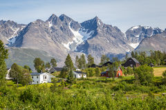 Scandinavian landscape with colorful wooden houses and a glacier royalty free stock images