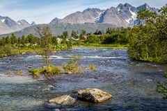 Scandinavian landscape with rapids in a  river and a glacier in Stock Image
