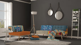 Scandinavian living room with colorful couch, armchair and soft Royalty Free Stock Photos