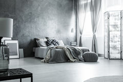Scandinavian monochromatic gray bedroom design royalty free stock image