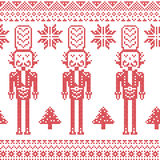 Scandinavian Nordic Christmas  pattern with nutcracker soldier , Xmas trees , snowflakes, stars, snow in red Stock Photography