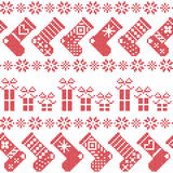 Scandinavian Nordic Christmas pattern with stockings, stars, snowflakes, presents in cross stitch in red. Graphic Stock Image