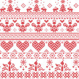 Scandinavian Nordic Christmas seamless cross stitch pattern with angels, Xmas trees, rabbits, snowflakes, candles in white and red Stock Images