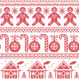 Scandinavian Nordic seamless pattern with ginger bread man, candy, ginger house, bauble, xmas trees in red cross stitch Royalty Free Stock Photo