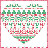 Scandinavian Nordic winter stitch, knitting  Christmas pattern in heart shape including snowflakes, Xmas trees, Christmas presents Royalty Free Stock Images
