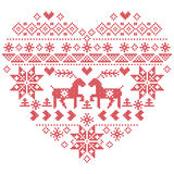 Scandinavian Nordic winter stitch, knitting christmas  pattern in  in heart shape shape including snowflakes, christmas trees,rein. Deer, snow, stars, decorative Stock Photos