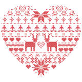 Scandinavian Nordic winter stitch, knitting  christmas pattern in  in heart shape shape including snowflakes, xmas trees,reindeer, Stock Photography