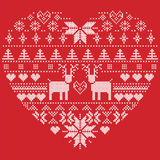 Scandinavian Nordic winter stitch, knitting  christmas pattern in  in heart shape shape including snowflakes, xmas trees,reindeer, Stock Image