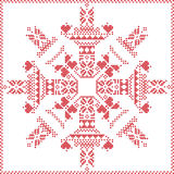Scandinavian Nordic winter stitch, knitting  Christmas pattern in  in  snowflake shape , with cross stitch frame including , snow Royalty Free Stock Photos