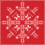 Scandinavian Nordic winter stitch, knitting  christmas pattern in  in  snowflake shape , with cross stitch frame including , snow, Stock Photography