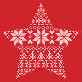 Scandinavian Nordic winter stitch, knitting  christmas pattern in  in star  shape shape including snowflakes, xmas trees, snow Stock Photo