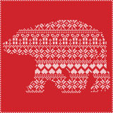 Scandinavian Nordic winter stitching  knitting  christmas pattern in  in polar bear   shape  including snowflakes, hearts xmas. Trees christmas presents, snow Stock Photography