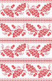 Scandinavian and Norwegian folk inspired festive autumn seamless pattern in cross stitch with acorn, oak leaf and  ornaments Stock Photography