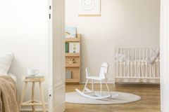 Scandinavian nursery with white wooden crib, with copy space stock image