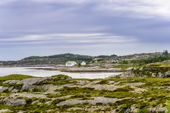 Scandinavian Ocean Bliss. A calming Ocean Vista with a gorgeous cloudscape and rocky island formations in the background and tide pools in the foreground Royalty Free Stock Photography