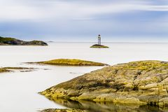 Scandinavian Ocean Bliss. A calming Ocean Vista with a gorgeous cloudscape and rocky island formations in the background and tide pools in the foreground Royalty Free Stock Photos