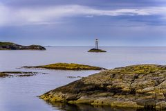 Scandinavian Ocean Bliss. A calming Ocean Vista with a gorgeous cloudscape and rocky island formations in the background and tide pools in the foreground Royalty Free Stock Images