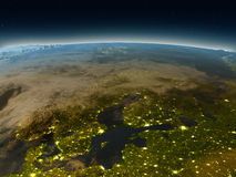 Scandinavian Peninsula from space in the evening. Scandinavian Peninsula in the evening from Earth's orbit in space. 3D illustration with detailed planet surface Royalty Free Stock Photos
