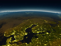 Scandinavian Peninsula from space in the evening. Scandinavian Peninsula in the evening from Earth's orbit in space. 3D illustration with detailed planet surface Stock Images