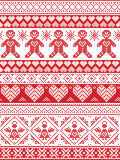 Scandinavian Printed Textile  inspired festive winter seamless pattern in cross stitch with Gingerbread man,  snowflake. Decoration elements, angel, hearts and Royalty Free Stock Photos