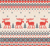 Scandinavian or Russian flat style knitted pattern with deers a Stock Photos