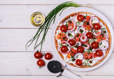 Scandinavian salmon pizza with cream cheese, capers, tomato and onion. Royalty Free Stock Photos