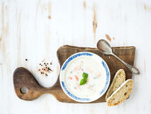 Scandinavian salmon soup with cream, fresh basil Royalty Free Stock Images