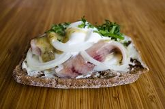Scandinavian sandwich with cream and herring close up stock photography