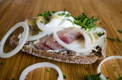 Scandinavian sandwich with cream and herring close up royalty free stock images