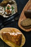 Scandinavian sandwich with smoked salmon fillet on black bread with soft cheese royalty free stock images