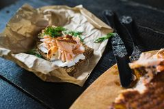 Scandinavian sandwich with smoked salmon fillet on black bread with soft cheese royalty free stock image