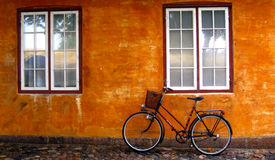 Scandinavian Scene. Typical Scandinavian scene of a bike with a basket against an old orange wall Stock Images