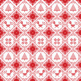Scandinavian seamless cross stitch inspired Nordic style Christmas pattern in cross stitch with robin, snowflake, star, decorative Stock Images