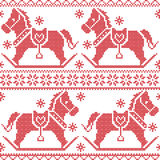 Scandinavian seamless Nordic Christmas pattern with rocking horses, snowflakes,hearts,  snow, stars, decorative ornaments in red c Royalty Free Stock Photography