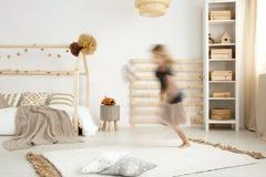 Scandinavian style bedroom. Girl running in a scandinavian style bedroom Stock Images