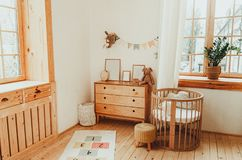 Free Scandinavian Style Children`s Room Interior. A Cozy Oval Baby Bed Cradle Stock Image - 160462721